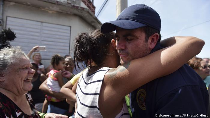 Puerto Rico Governor Ricardo Rossello is greeted by a resident in Barrio Obrero