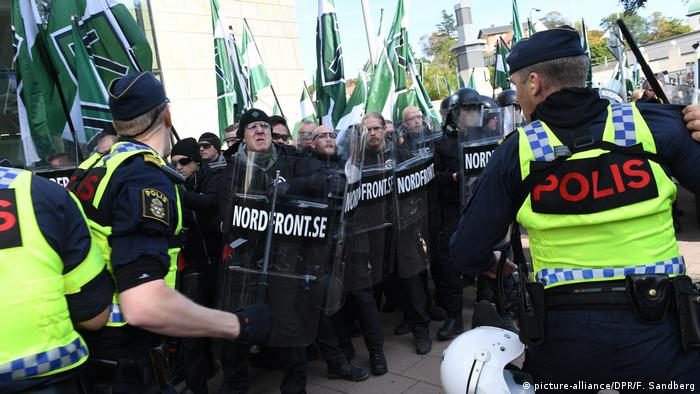 Neo-Nazis march in Goteborg, Sweden prepared for a fight, brandishing shields as they face-off with police