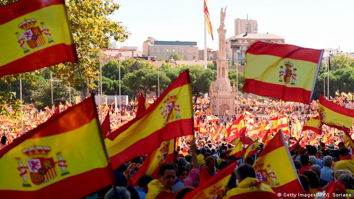 Protestors gather holding Spanish flags during a demonstration against independence of Catalonia called by DENAES foundation for the Spanish Nation Defence at Colon square in Madrid