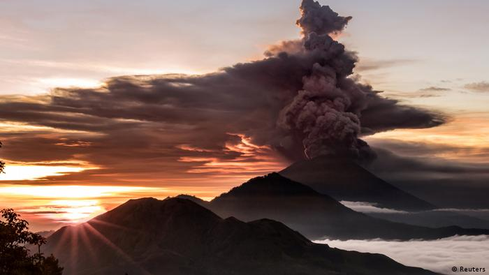 A huge cloud spews from Mount Agung in Bali