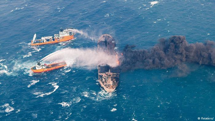 Ships spray foam onto the burning Sanchi oil tanker in the South China Sea (Reuters/)
