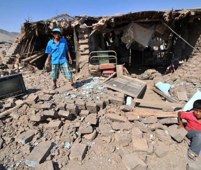 A Man And A Child In The Rubble In Peru Reuters D Ramos