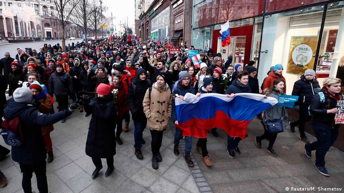 Supporters of Russian opposition leader Alexei Navalny take part in a procession during a rally for a boycott of a March 18 presidential election in Moscow, Russia