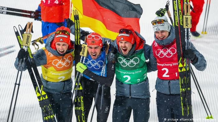 Germany's Nordic Combined team celebrate