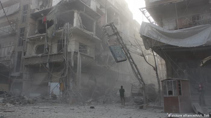 Destroyed buildings are seen after Assad Regime's airstrike hit residential areas in eastern Ghouta