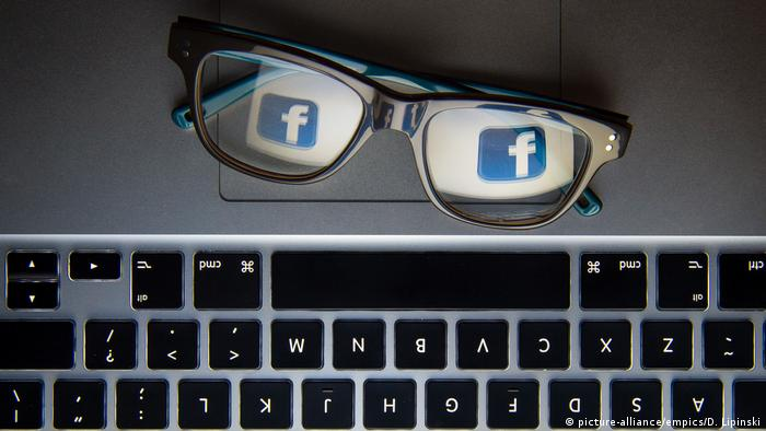 Glasses with Facebook logo reflected on lenses