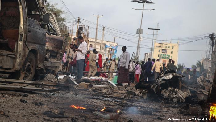 People gather at the scene of a bomb explosion in Mogadishu (Getty Images/AFP/A.H. Farah)