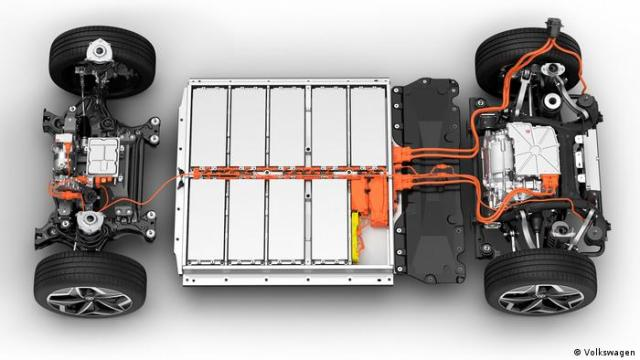 A picture showing the chasis of an electric vehicle with a big battery sitting in the middle betweeen the two axis