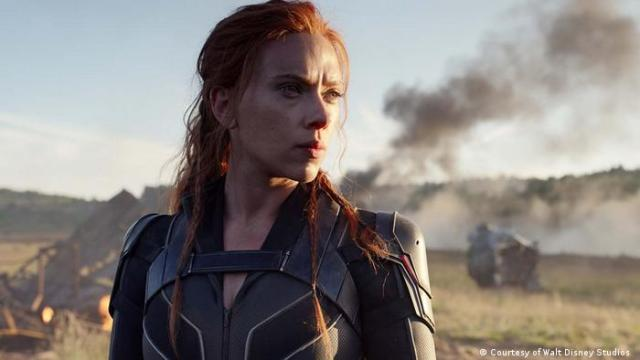 Actress Scarlett Johansson in an outdoor action scene with something burning in the background (Courtesy of Walt Disney Studios )