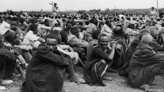 Kenya's Mau Mau fighters seating on the ground