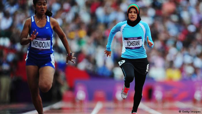 Tahmina Kohistani of Afghanistan competes in the Women's 100m Heats on Day 7 of the London 2012 Olympic Games