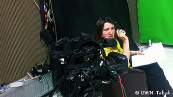 Jeta Xharra prepares for an interview at her studio in Prishtina, Kosovo.March 3, Prishtina, Kosovo. (photo: Nate Tabak)