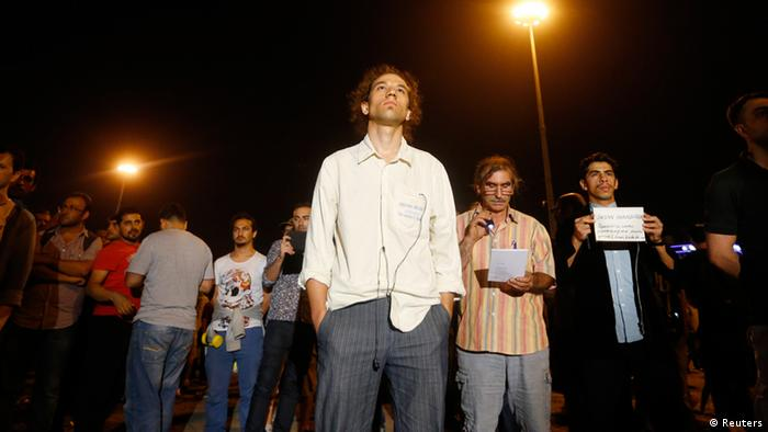 Erdem Gündüz (center) stands in a silent protest at Taksim Square in Istanbul early June 18, 2013, Photo: REUTERS/Marko