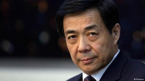 China's former Chongqing Municipality Communist Party Secretary Bo Xilai looks on during a meeting at the annual session of China's parliament, the National People's Congress, at the Great Hall of the People in Beijing, March 6, 2010. China has charged disgraced former senior politician Bo Xilai with bribery, abuse of power and corruption, state news agency Xinhua said on July 25, 2013, paving the way for his trial. Picture taken March 6, 2010. REUTERS/Jason Lee (CHINA - Tags: POLITICS CRIME LAW)