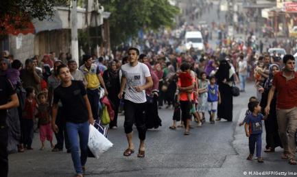 Palestinians flee their homes in Gaza's eastern Shejaia district on July 20, 2014, after heavy Israeli shelling that left casualties lying in the streets. MOHAMMED ABED/AFP/Getty Images)