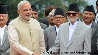 Nepalese Prime Minister Sushil Koirala (R) shakes hands with Indian Prime Minister Narendra Modi on his arrival at Tribhuvan International Airport in Kathmandu on August 3, 2014<br /><br /><br /> (Photo: PRAKASH MATHEMA/AFP/Getty Images)
