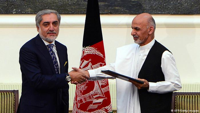 Afghan presidential candidates Abdullah Abdullah (L) and Ashraf Ghani Ahmadzai shake hands after signing a power-sharing agreement at the Presidential Palace in Kabul on September 21, 2014<br /> (Photo: WAKIL KOHSAR/AFP/Getty Images)