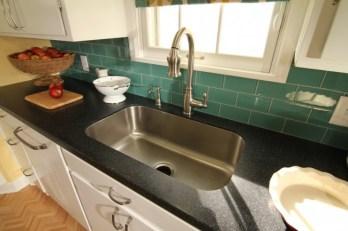 teal subway tile kitchen backsplash