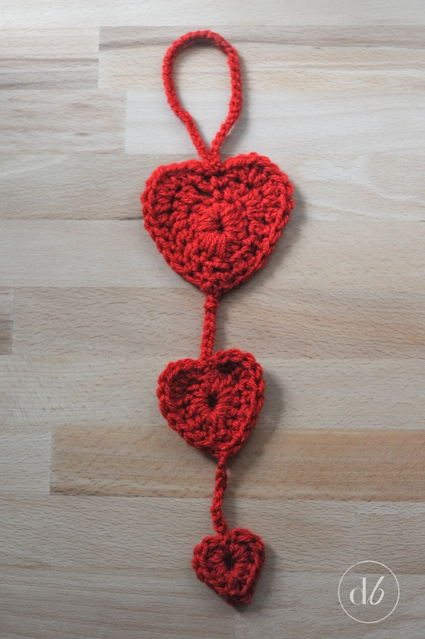 After I added the two smaller hearts my crocheted heart door hanger was complete! & Crocheted Heart Door Hanger - Dwell Beautiful