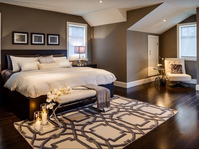 modern-master-bedroom-with-wood-ceiling-accent-wall-and-vaulted-ceiling