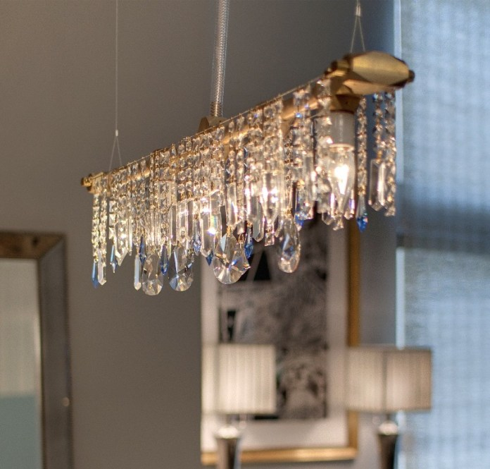 modern-linear-chandelier-design-with-crystals-and-grey-wall