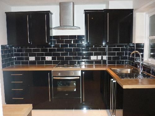 Black-Subway-Tile-Backsplash-in-Black-Kitchen