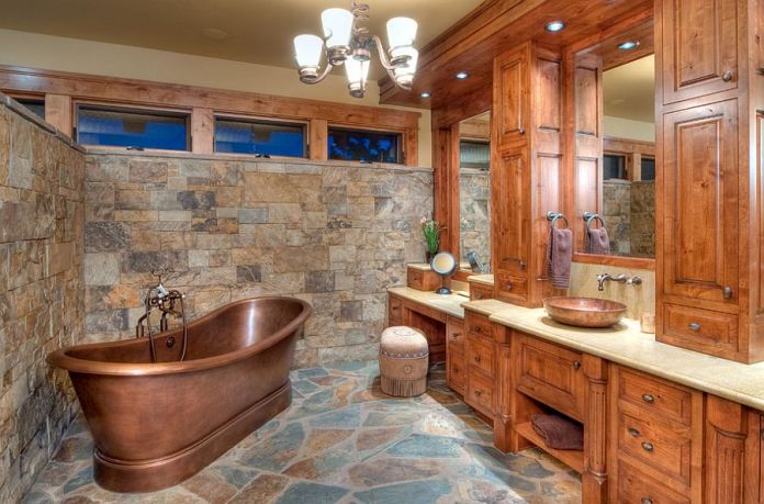 Rustic Bathroom Featuring Copper Bathtub with Double Vanity