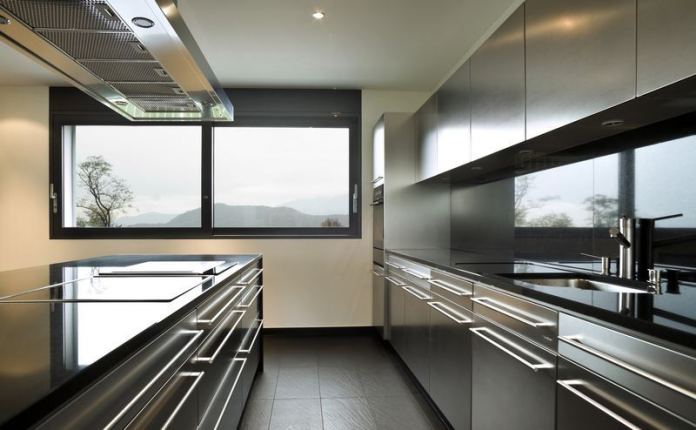Stainless Steel Kitchen Cabinets with Black Countertops