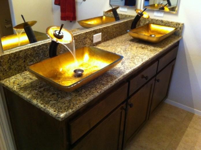 Unique-Shaped-Bathroom-Sinks-in-Vessel-Design-on-Granite-Countertop-with-Exclusive-Wooden-Vanity-800x597