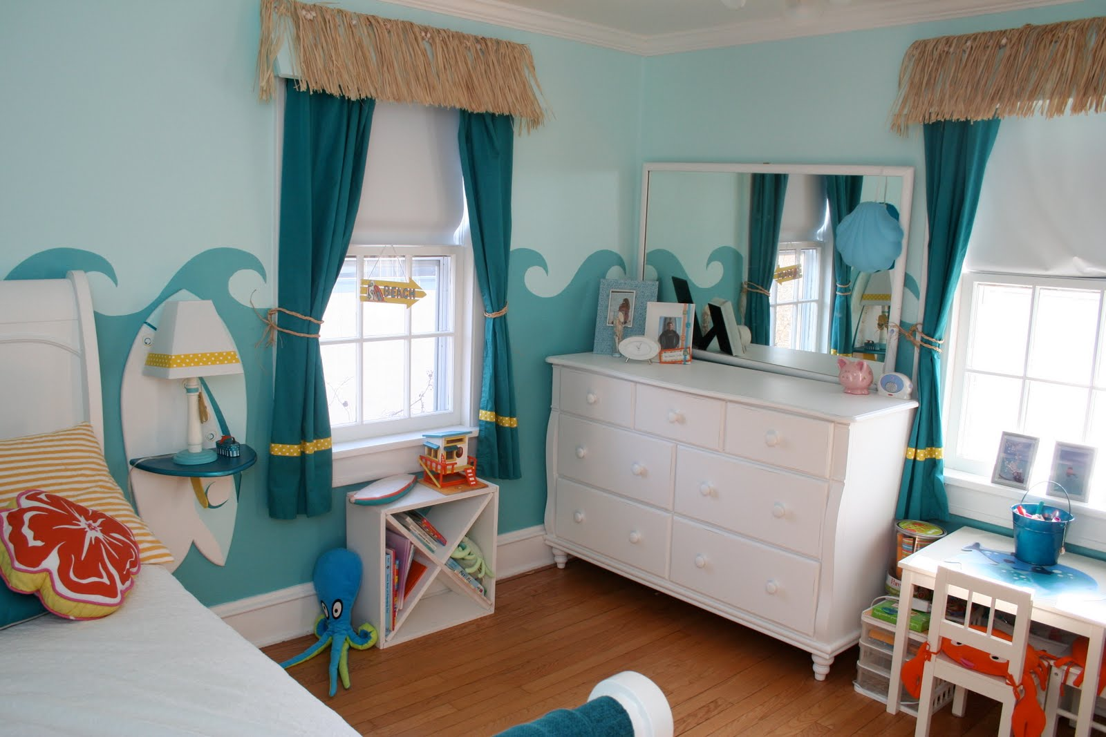Beach Inspired Bedroom With Blue Sea Wall