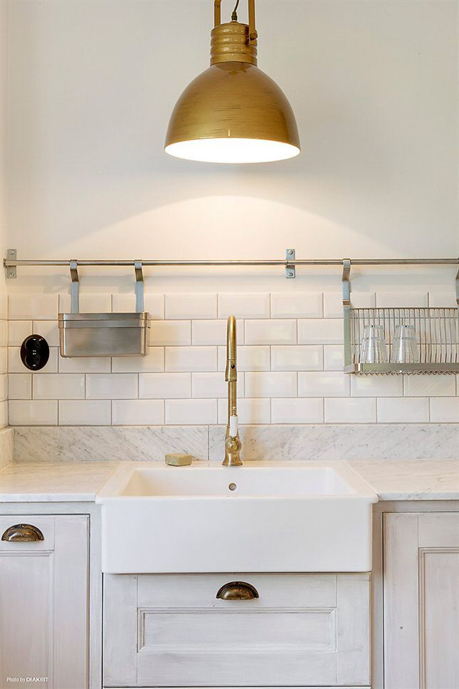 Brass Accents and a Stainless Pot Rail