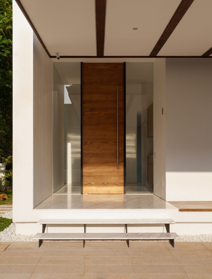 Contemporary wood entry door with fiber glass support