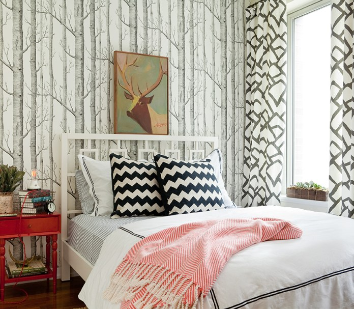 Eclectic bedroom with monochromatic look with lots of black and white accents and wood tones