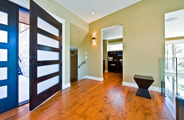Welcoming entryway with cool front door with frosted glass