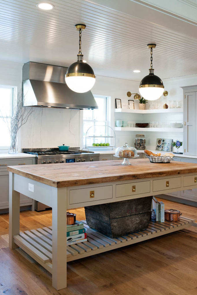 gray painted kitchen with brass hardware