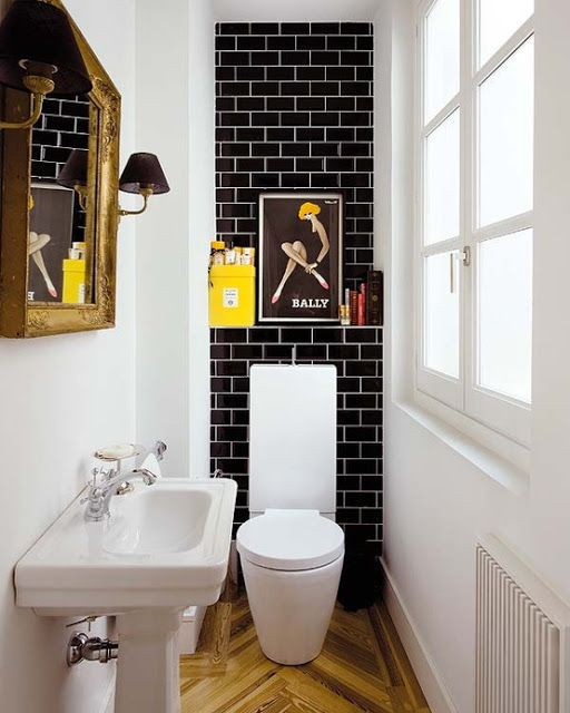Tiny Modern bathroom with black Subway Tile and white grout