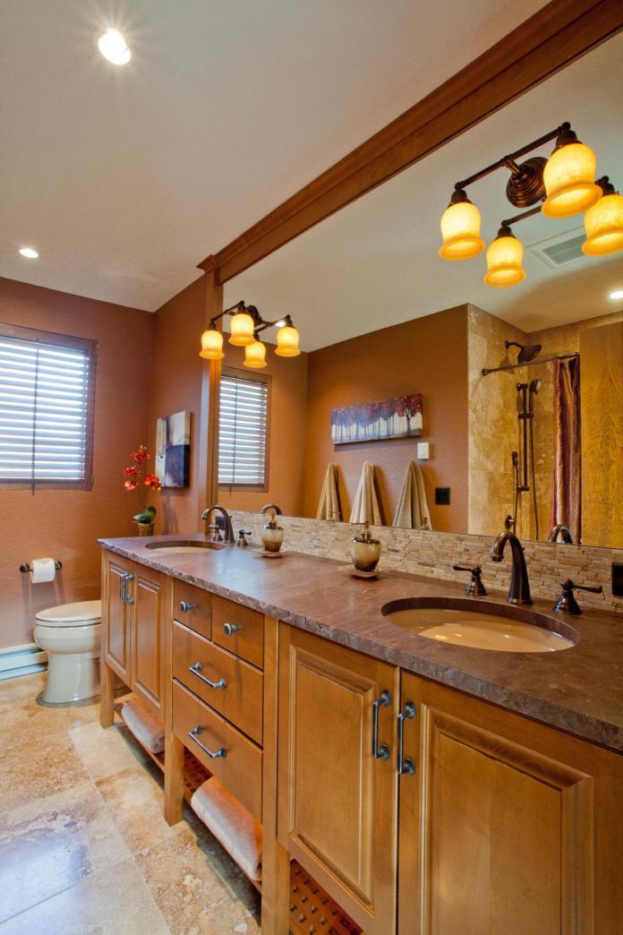 Brown Craftsman Bathroom With Long Double Vanity