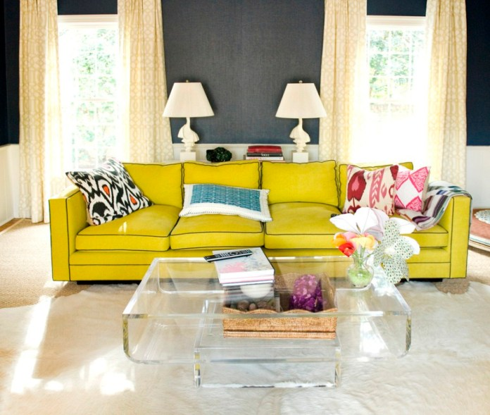 Glossy-Yellow-Sofa-plus-Assorted-PIllows-facing-Transparent-Table-with-Space-Saving-Beautified-by-the-Flower-for-Eclectic-Living-Room
