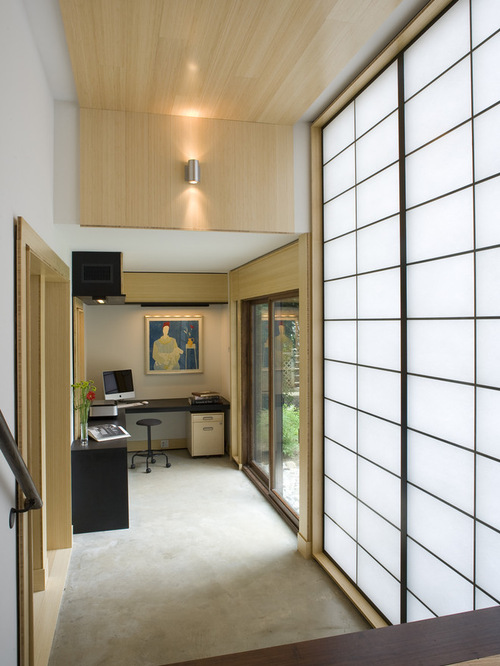 Asian Home Office Design Photos with Concrete Floors