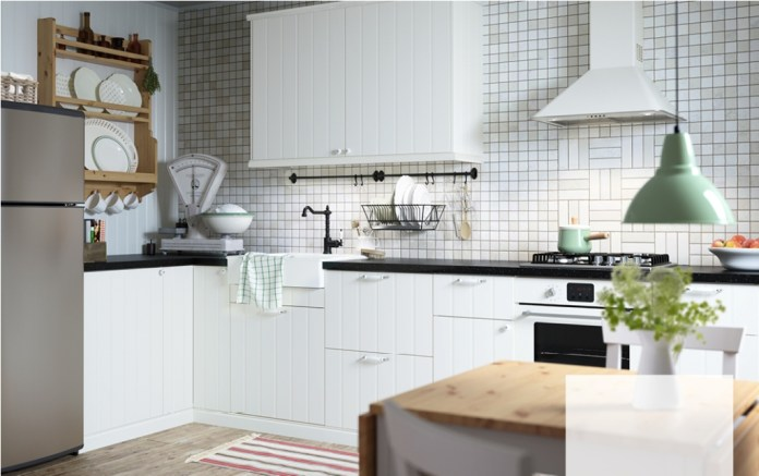 off-white country kitchen with black worktops