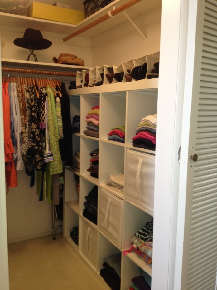 white wooden closet with racks and shoe racks complete with brown wooden cloth hooks