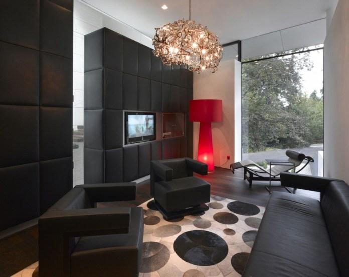 Black Tufted Wall With Dark Semi Glossy Hardwood Floor