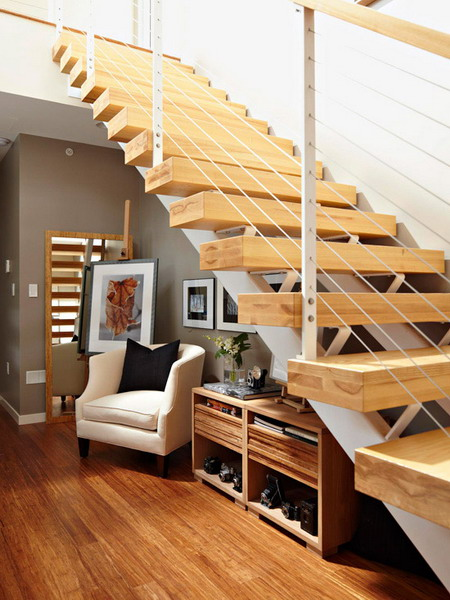Storage and sitting area under stairs