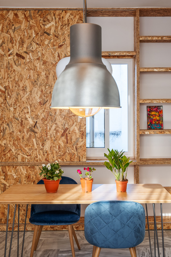 Industrial Dining Room With Multicolored Walls Dwellingdecor