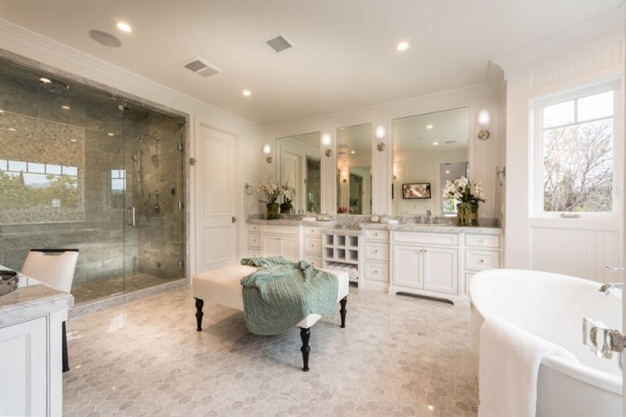 Elegant master bathroom with luxury furnishings and decor