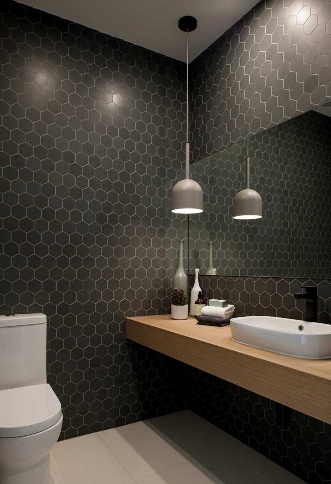 Black hexagonal inserts on the walls with spots of light to increase the illumination