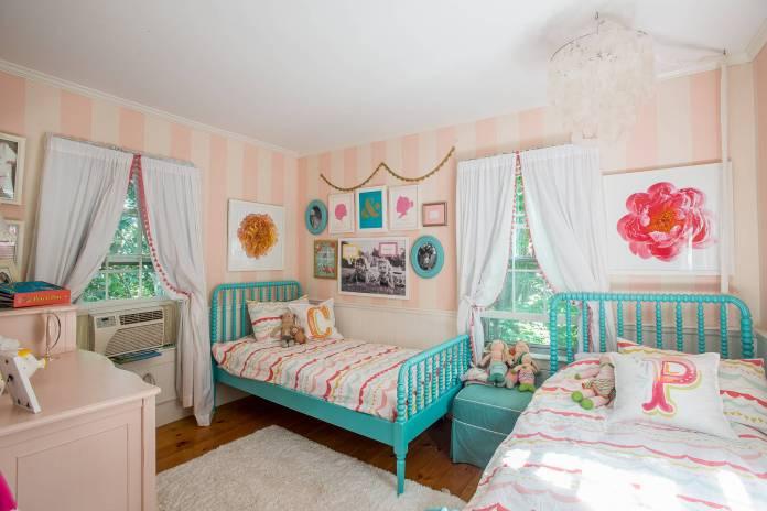 Medium tone wood floor room with lots of colors