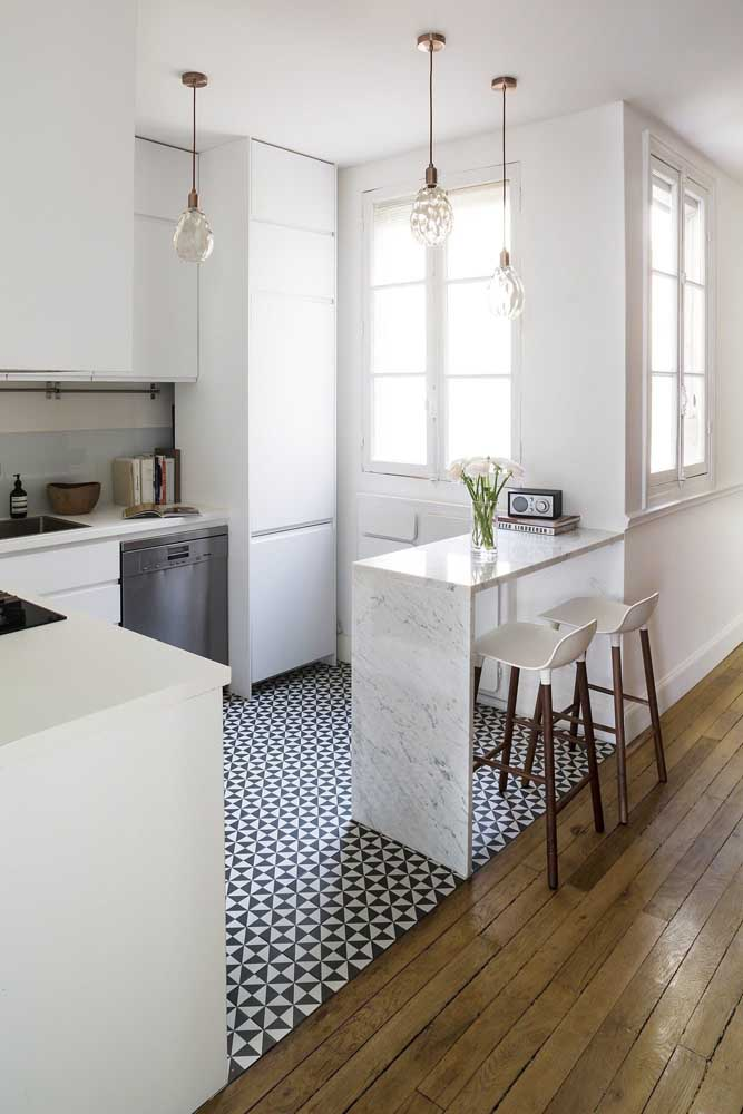 03. Inspiring small kitchen with marble counter and custom cabinets