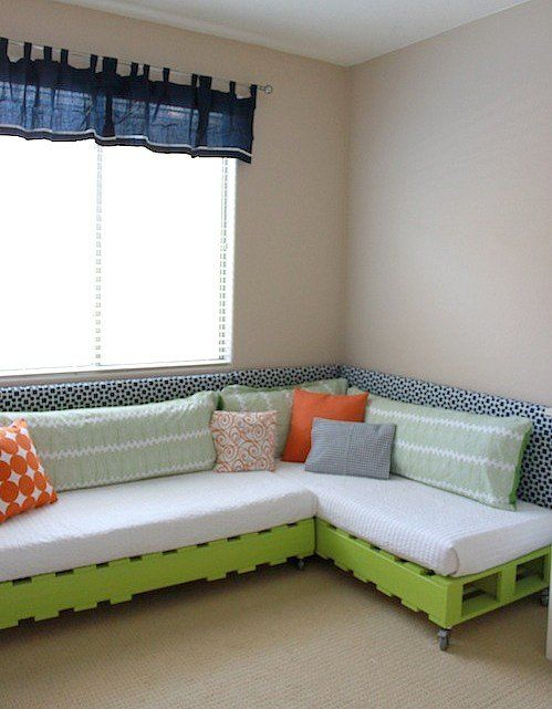 09. Pallet corner sofa with green paint and colorful pillows