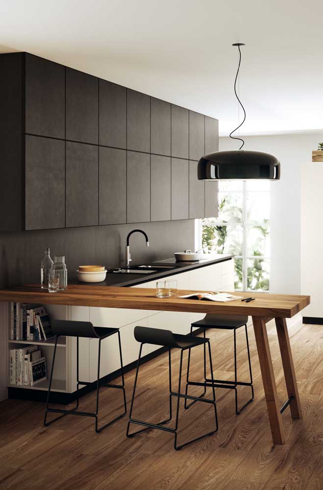 19. A luxury in this small American kitchen with black cabinets.